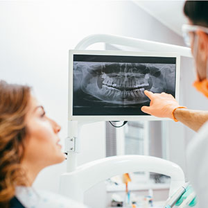 Doctor and female patient looking at xray