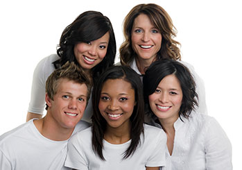 Group of 5 people in white smiling